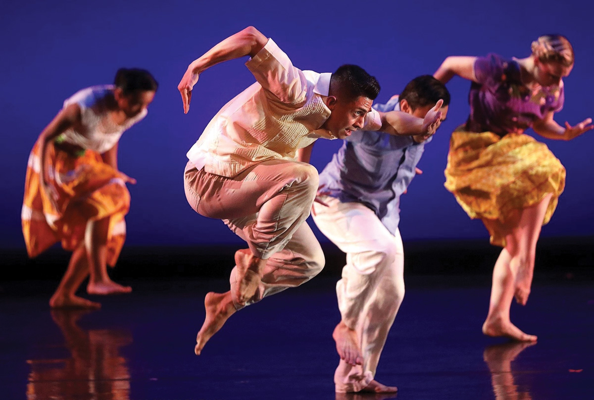 "Edgar Aguirre performs with UCI's Etude Ensemble in ""Uprooted  Pero: Replantado,"" choreographed by Donald McKayle."